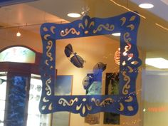 painted the lazer cut frame and hung sunglasses in the middle for a winter window display.