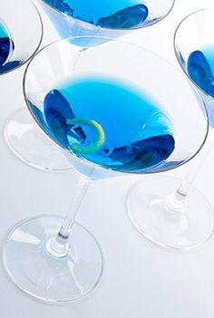 Blue Cottontail:1-1/2 ounces vodka, 1/2 ounce triple sec, 1/4 ounce blue Curacao, Orange peel (for garnish)