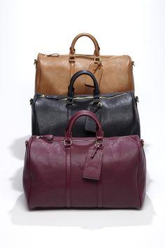 Top handle vegan weekender bag with adjustable, detachable shoulder strap and removable luggage tag. Dust bag included.