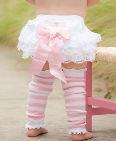 Your little one will feel like a royal princess in this lace-decorated RuffleButt bloomer
