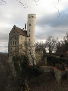 Lichtenstein Castle is situated on a cliff located near Honau in the Swabian Alb, Baden-Württemberg, Germany. Historically there has been a castle on the site since around 1200. It was twice destroyed, once in the Reichskriegs war of 1311 and again by the city-state of Reutlingen in 1381. The castle was not reconstructed and subsequently fell to ruin.  In 1802 the land came into the hands of King Frederick I of Württemberg, who built a hunting lodge there. By 1837 the land had passed to his