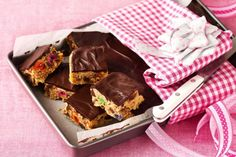 Midnight feast slice  This slice is inspired by New York cafe Momofuku Milkbar's famous 'compost cookies', made from leftover sweet and savoury snacks. An unusual mix of pretzels, Snickers, potato chips and jelly beans is baked into a slice and topped with dark chocolate.