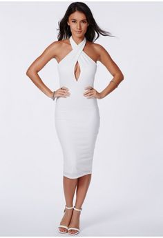 For a stylish yet sexy vibe for SS14, this halterneck piece is ideal. The lush ribbed fabric and deep plunge neckline are totally on trend for summer. Style it up with suede strappy heels and a box clutch.  Fully lined   Approx length 1...