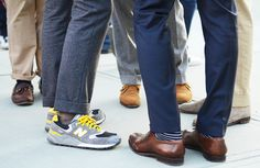 I love the irreverence of a pair of bright New Balance sneaks with turned up chinos on a guy; it's like he could step straight outta street style and onto a court or field.