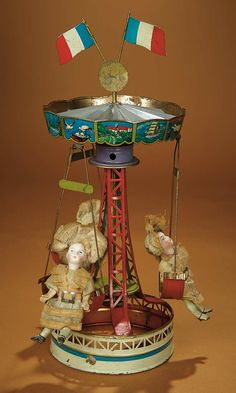 Bread and Roses - Auction - July 26, 2016: Lot #75 German Lithographed Tin Carousel with Original Miniature Bisque Dolls