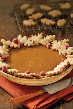 Classic Pumpkin Pie: Pastry oak leaves look pretty and hide crust imperfections. For quick color, dot with fresh cranberries that you've coated with corn syrup and rolled in sugar.