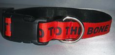"""""""Bad To The Bone"""" surrounds this black nylon webbing  1"""" wide collar with decorative bones in between! Rich with color, this collar is an outstanding addition for any dog!    A black buckle and adjustment glide are complimented with a metal D ring.     PLEASE SPECIFY RED OR BLACK BACKGROUND WHEN ORDERING.    If you would like this collar in another size or style, please message or email us and we will be happy to create the collar to your liking.   Shop this product here…"""