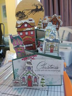 Ctmh Christmas village stamp on a cascading card by Lora wall