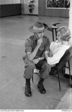 At Sydney (Kingsford Smith) Airport, an unidentified young Australian soldier and his wife say goodbye to each other as he is about to board a Qantas flight to South Vietnam. c February 1967.