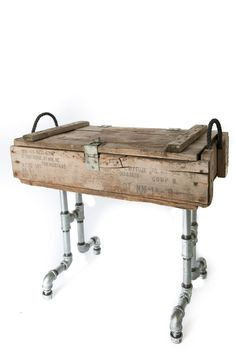 This side table is made from galvanized pipe and an ole military mortar ammo box. If you're looking for a piece of furniture with history, than look no further. 14 1/4 X 26 1/2 X 23 SOLD $130 Tag: industrial pipe furniture urban diy iron vintage wood crate Bo metal
