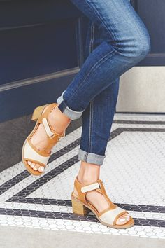 Put a spring in your step with these neutral-tone leatherlike sandals.
