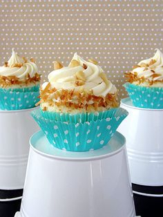 DELICIOUS White Chocolate Coconut Cupcakes - white chocolate cupcake infused with coconut extract and topped with white chocolate cream cheese #cupcake #recipe