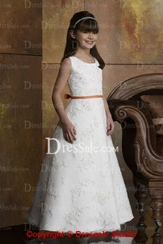 This enjoyable dress for flower girls features a fitted bodice with red tank straps dotted with shimmering embellishments. Striking embroidery on the bodice gives the dress a fanciful image. Flare A-line skirt flows down to the floor with a sweep train.