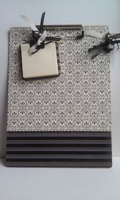 Mod podge a clipboard with scrapbook paper. Add a matching post-it-note mini clipboard for a cute gift idea.