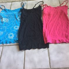 Cami Lace Bundle Dark Black is from Rue 21, pink&blue floral are from Aeropostale. All feature lace around top and bottom. All are small. Also all have adjustive straps. May be sold separately. All have been used, but no flaws No Trades Aeropostale Tops Camisoles