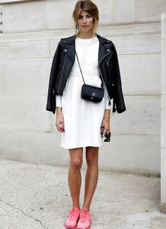 5 Ways To Dress Up Sneakers - black leather jacket worn with a white dress + pink sneakers and a mini crossbody bag