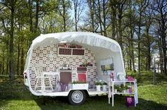 Adorable way to repurpose a defunct camper by turning it into an outdoor retreat!