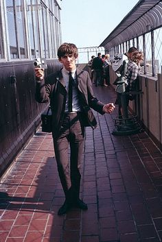 ": "" George Harrison on top of The Empire State Building, in "" So George was actually in New York before the famous Beatles US visit in (x) Paul Mccartney, John Lennon, Stuart Sutcliffe, Liverpool, Ringo Starr, George Harrison Documentary, Beverly Hills, Olivia Harrison, George Harrison Young"