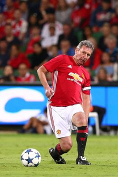 Bryan Robson of the Manchester United Legends passes the ball during the Manchester United Legends and the PFA Aussie Legends match at nib Stadium on March 25, 2017 in Perth, Australia.