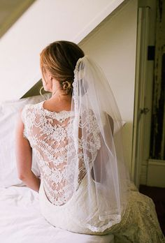Brides.com: Wedding Hairstyles that Work Well with Veils. A Loose, Low Updo Wedding Hairstyle. Pull some front pieces out of this low twisted bun for a slightly undone look. The vintage-looking Chantilly lace fingertip veil adds romance and sophistication.   Browse more wedding updos.