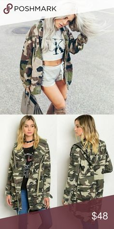 "Green Camo Jacket Edge up just about any outfit with our green camo army jacket. Features zipper front closure, double flap, long sleeves and drawstring bottom.?  - 100% Cotton - Length: (Measured in a size small) 37"" Jackets & Coats"