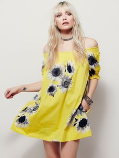 Clementine Mini Dress | This off-the-shoulder mini dress is printed with a large scale floral design. In an oversized and effortless silhouette, this style is featured in a lightweight fabrication with hip pockets and ruffed trim at the sleeves. Elastic band at the cuffs and bust and triple button closures in back.