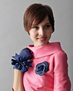 """Navy Gloves and Flower Accessory    Festive floral pins give a nod to the camellias Coco Chanel wore on her lapel. """"Pearl"""" dress, Lynn Lugo. Flower, Tinsel Trading Company. Gloves, Gaspar Gloves. Single-faced satin ribbon for gloves and belt, both Mokuba New York, 212-869-8900."""