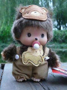 Monchichi dressed as a bear.