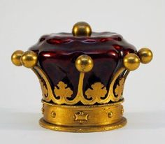 "A 19th century Cranberry glass inkwell with Gilded Bronze fittings by ""Jenner & Knewstub, 33 St. James St. (London)"". Crown form with Bronze."