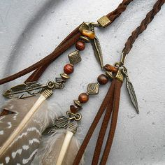 Free Spirit - Upper Arm In The Wind - saddle brown braided suede with peasant feathers tigers eye charms