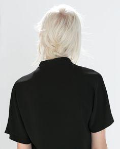 white hair. black shirt.