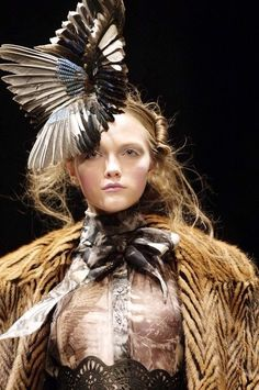Love this feathered hat ! This outfit was designed by Alexander McQueen if I am correct