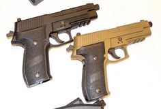 New and Unusual Gear From the 2015 NRA Annual Meeting, A pair of air-powered P226s.
