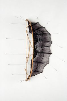 Maureen Kelman, Shibori dyed silk stretched and pulled between wire armatures or bent bamboo structures.