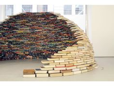 Book Igloo: Home is a recent sculptural installation by Colombian artist Miler Lagos. The piece was constructed at MagnanMetz Gallery late last year using carefully stacked books to create a compact dome that is entirely self-supporting