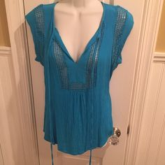 "Blue sleeveless top Mesh details and can tie in the front. About 24"" long. Daniel Rainn Tops"