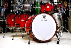 Sakae Celestial 5pc Drum Set Rosy Red Tamo w/ Black HW 22x16, 10x7, 12x8, 14x13, 16x14. Drums only; hardware/stands sold separately. This drum kit was displayed at the 2015 NAMM show and shows wear on the heads as a result. The kit is otherwise in new condition! Purchase Here: http://www.drumcenternh.com/drums/drum-sets/sakae-celestial-5pc-drum-set-rosy-red-tamo-w-black-hw.html