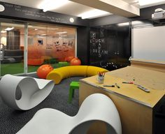 A fun and playful meeting room with writable walls, space hoppers and funky seating.