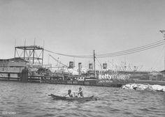 News Photo : Native outrigger in Manila Harbor.