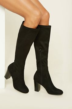 18db05f7819 A pair of faux suede knee-high boots