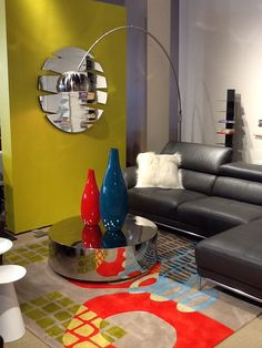 Giordano Leather Sectional, DR Elements Wool Rug, Large Metal Arc Lamp,  Sapien Bookshelf
