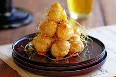 Golden profiterole puffs of perfection are not as difficult as you think, so enjoy and indulge your tastebuds!