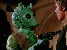 Greedo - Rodian bounty hunter who serves Jabba the Hutt. Shot and killed by Han Solo at the Mos Eisley Cantina in A New Hope. Star Wars Canon, Original Trilogy, George Lucas, A New Hope, Cincinnati Bengals, Star Wars Characters, Star Wars Art, Star Trek, Dark Side