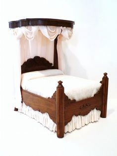 "Nancy Summers Half Tester Bed. Imposing hand-carved Civil War era walnut half-tester bed, beautifully upholstered in brocade pongee silk with elegant drapery. 8"" H, 7"" L, 5"" W"