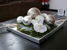 Christmas piece with baubles and Orchid