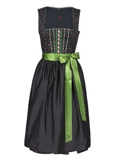 A Grassy green looks so sharp against a sea of black in this traditional dirndle dress.