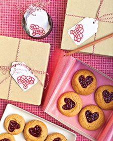 So cute!  Make PB cookies, once dough balls are on cookie sheet, use fingers to make overlapping indentations to create heart.  Bake and add 1/2 tsp jam to fill warm cookies.  From Martha Stewart.