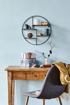 Round shelving unit with wooden shelves. An interesting way to break with straight lines in your home's interior decor. Price per item £16.86