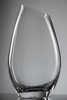 """love it.  thinks it's elegant and beautiful  Quality Glass Vases 8.5""""  Slant Rim $4.99 each/ 3 for $4 each"""