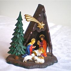 Nativity -  We had this on our first Christmas tree in 1962, and have used it every Christmas for 50 years.  It isn't Christmas until it is on the tree!